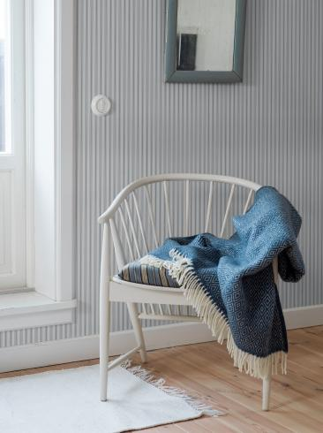 The wallpaper Aspö Stripe from Boråstapeter. The wallpaper design and pattern is blue and consists of Stripe