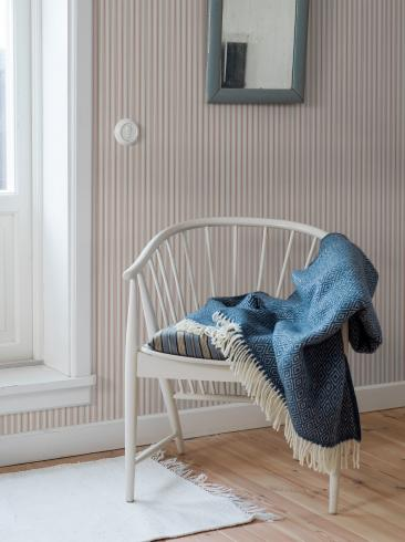 The wallpaper Aspö Stripe from Boråstapeter. The wallpaper design and pattern is red and consists of Stripe