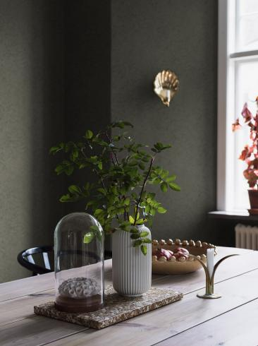 The wallpaper Bladverk from Boråstapeter. The wallpaper design and pattern is green and consists of Archive Foliage