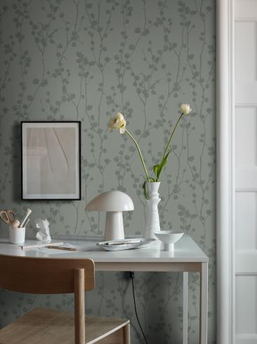 The wallpaper Disa from Boråstapeter. The wallpaper design and pattern is green and consists of Foliage
