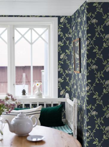 The wallpaper Honeysuckle from Boråstapeter. The wallpaper design and pattern is blue and consists of Floral Trellis