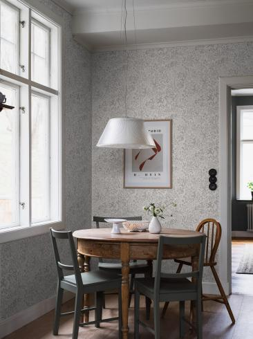 The wallpaper Nocturne from Boråstapeter. The wallpaper design and pattern is grey and consists of Archive Floral Foliage