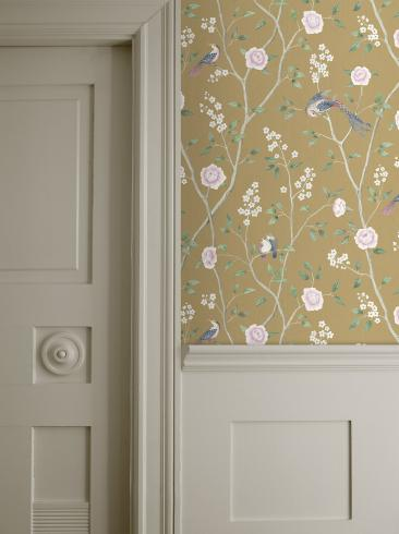 The wallpaper Paradise Birds from Boråstapeter. The wallpaper design and pattern is yellow and consists of Floral