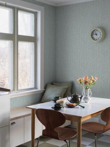 The wallpaper Schlager from Boråstapeter. The wallpaper design and pattern is turquoise and consists of Archive