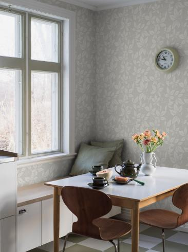 The wallpaper Vildvin from Boråstapeter. The wallpaper design and pattern is green and consists of Archive Foliage