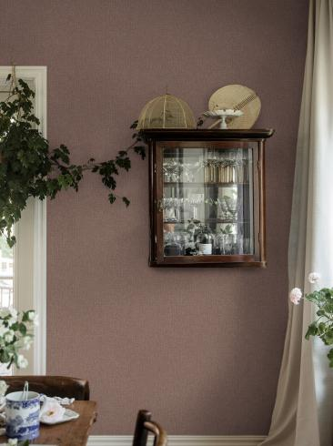 The wallpaper Weaver´s Wall from Boråstapeter. The wallpaper design and pattern is pink and consists of Single Colour