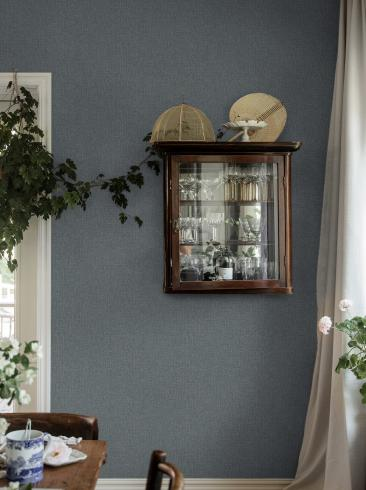 The wallpaper Weaver´s Wall from Boråstapeter. The wallpaper design and pattern is blue and consists of Single Colour