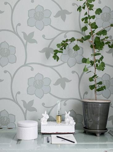 The wallpaper Clematis from Engblad & Co. The wallpaper design and pattern is turquoise and consists of Floral Graphic