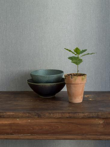 The wallpaper Harvest Stripe from Boråstapeter. The wallpaper design and pattern is green and consists of Stripe