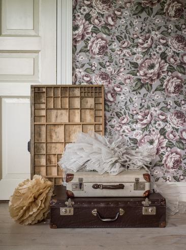 The wallpaper Rosie from Boråstapeter. The wallpaper design and pattern is purple and consists of Children's Floral