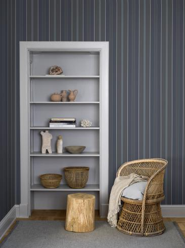 The wallpaper Stockholm Stripe from Boråstapeter. The wallpaper design and pattern is blue and consists of Stripe
