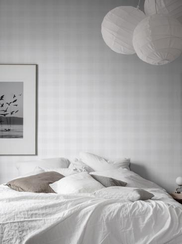 The wallpaper Tartan Check from Boråstapeter. The wallpaper design and pattern is white and consists of Checked