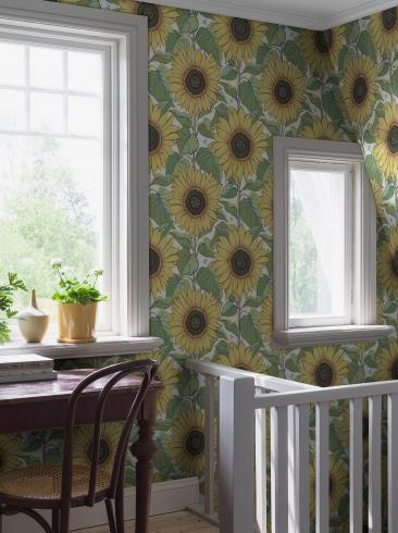 The wallpaper Solrosor from Boråstapeter. The wallpaper design and pattern is yellow and consists of Floral Foliage